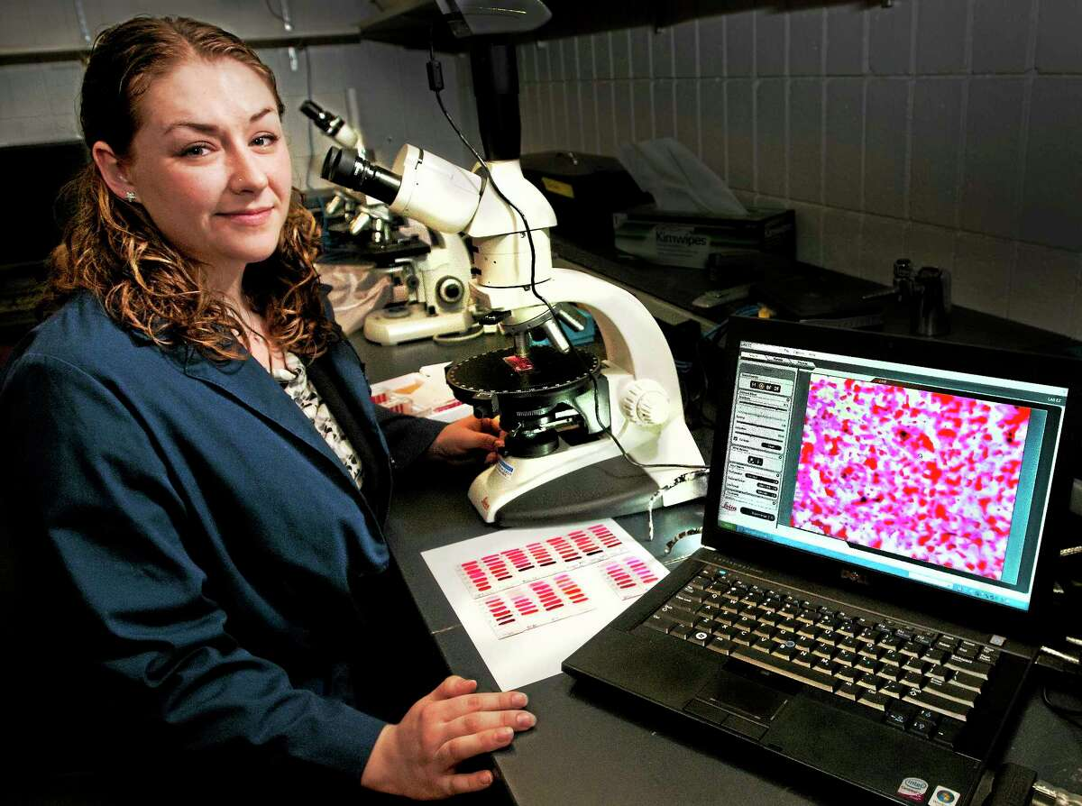 (Melanie Stengel - New Haven Register) University of New Haven Graduate student, Nicole Bois has completed research on nail polish as evidence. A sample being viewed under the microscope is displayed on her laptop 4/8.