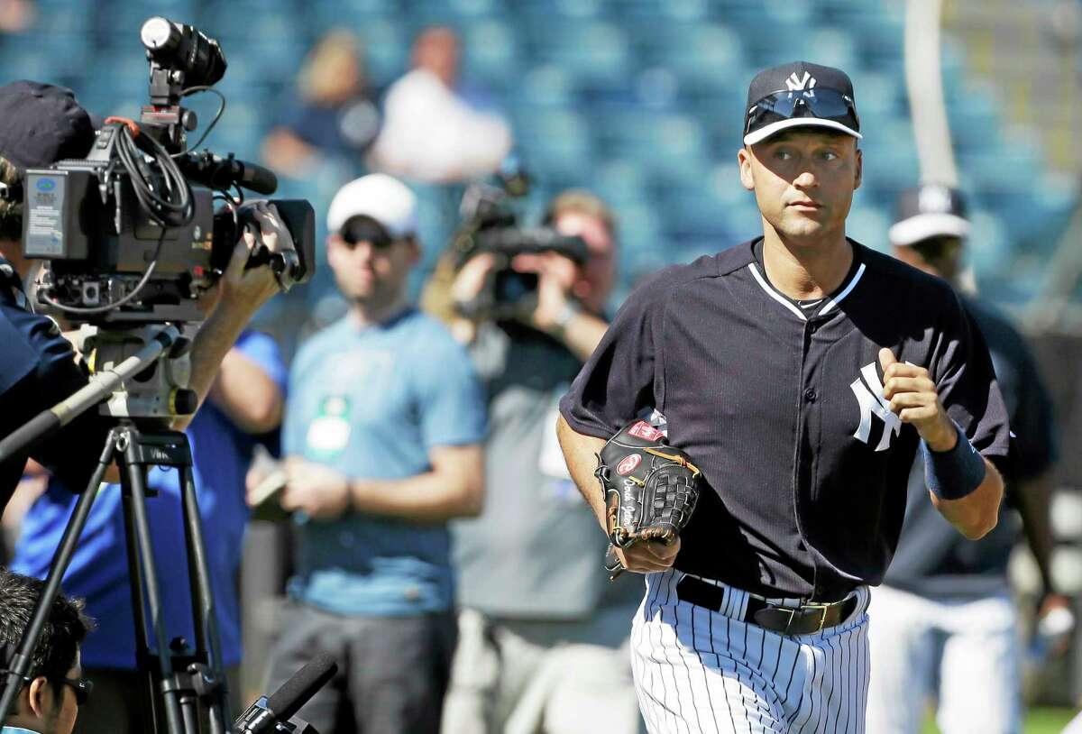 New York Yankees shortstop Derek Jeter runs to the field before practice Thursday in Tampa, Fla.