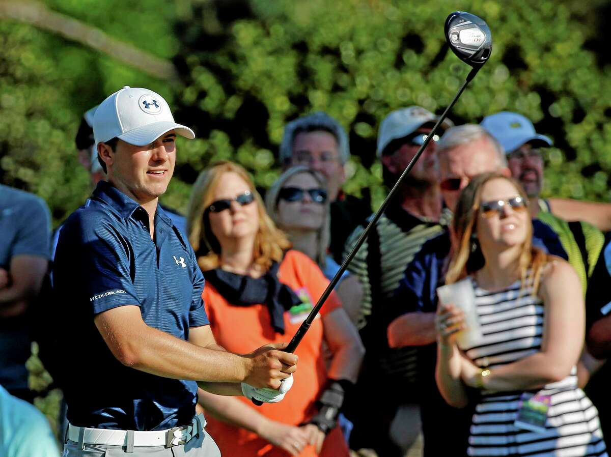 Jordan Spieth watches his tee shot on the 15th hole during the third round of the Masters Saturday.