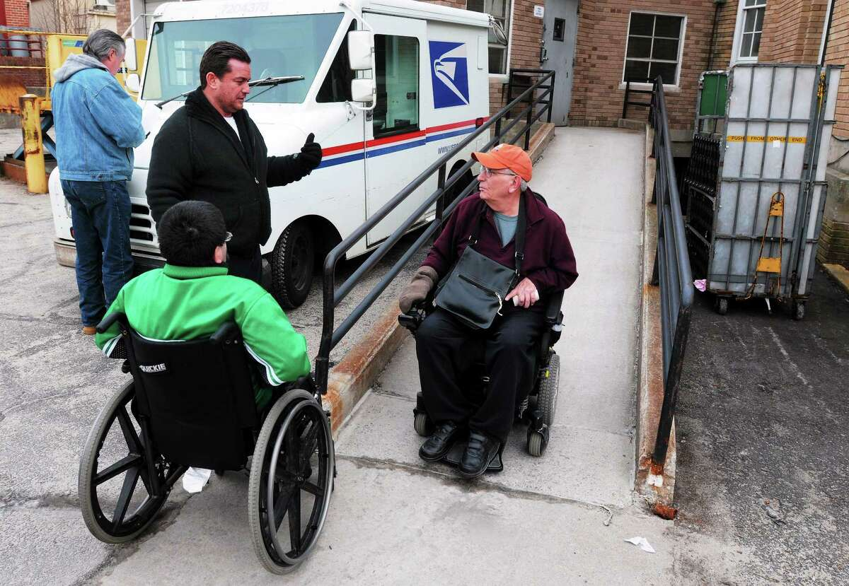 (Mara Lavitt ó New Haven Register) January 20, 2013 Seymour Seymour town engineer Jim Galligan, and Seymour's Director of Economic Development Fred A. Messore with Galligan's son Kevin (of North Branford) and Joseph Luciano of Seymour discuss the lack of proper handicapped access to the town's post office.
