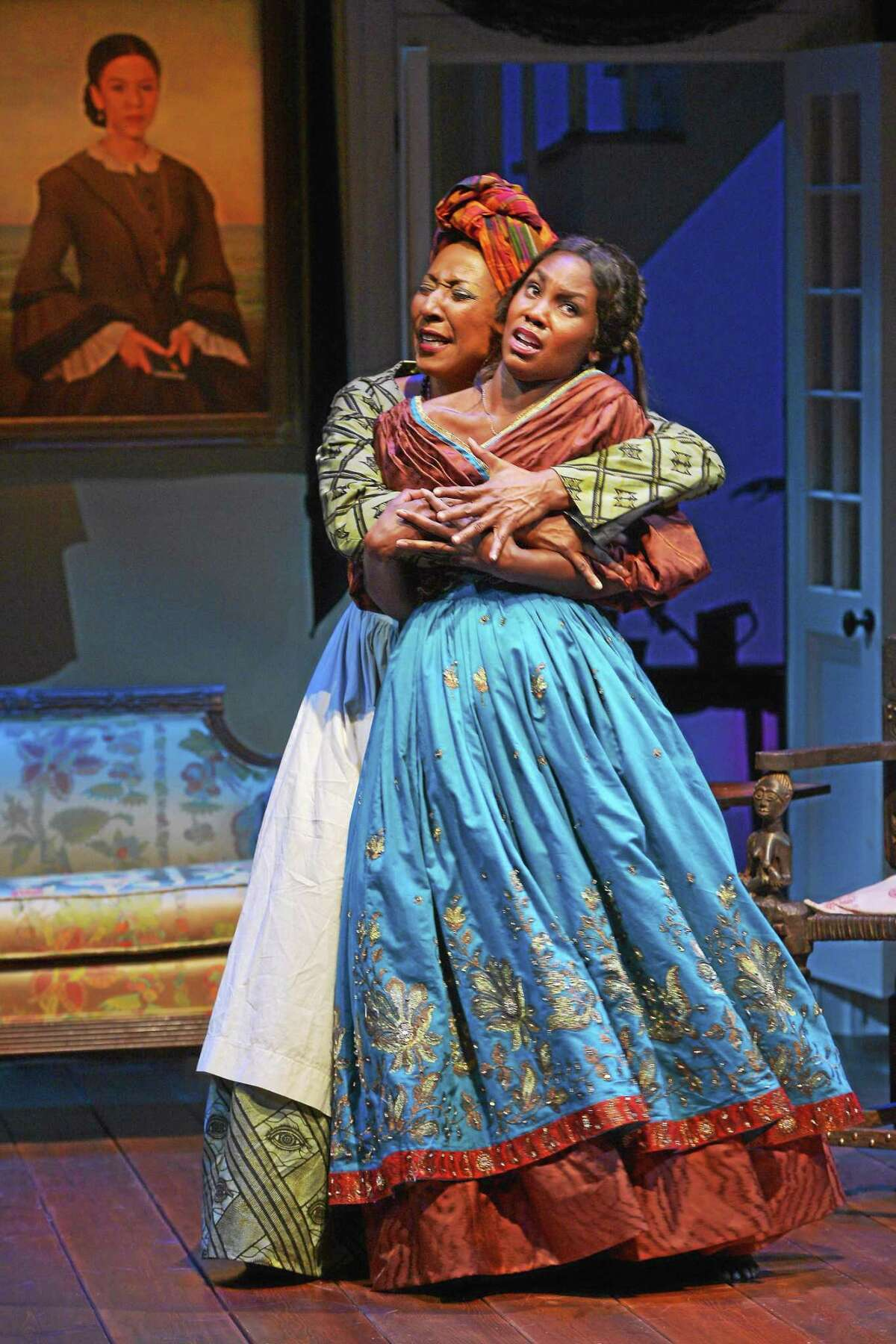 """Harriett D. Foy (Makeda), left, and Joniece Abbott-Pratt (Odette) in a scene from """"The House that will not Stand,"""" a world premiere co-production with Berkeley Repertory Theatre."""