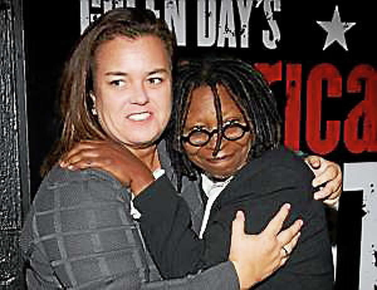 Rosie O'Donnell and Whoopi Goldberg arrive at the opening night performance of the Broadway musical 'American Idiot' in New York, Tuesday, April 20, 2010.