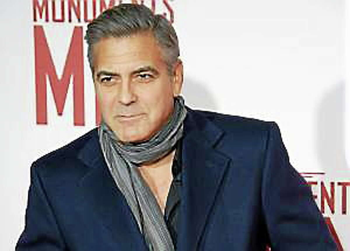 """American Actor George Clooney attends the UK Premiere of """"The Monuments Men"""" in London on Tuesday 11 February, 2014."""