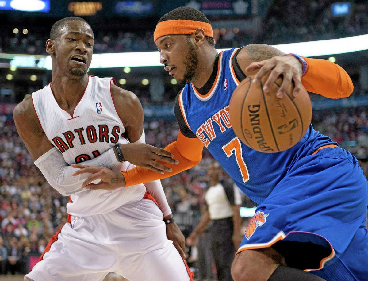Toronto Raptors guard Terrence Ross (31) defends New York Knicks forward Carmelo Anthony in Friday's game.