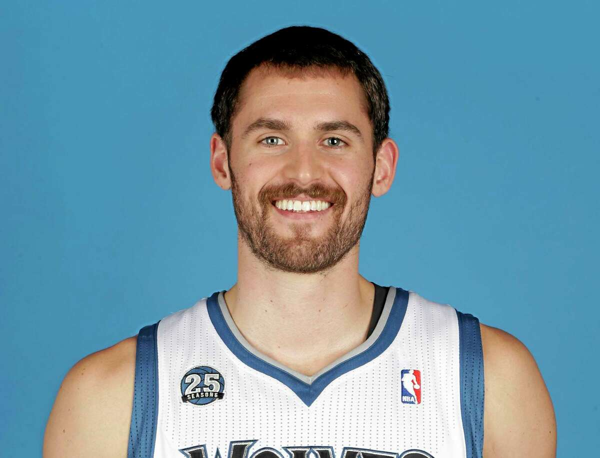 FILE - This is a Sept. 30, 2013 file photo showing Minnesota Timberwolves' Kevin Love posing at the NBA basketball teams media day in Minneapolis. Two people with knowledge of the deal tell The Associated Press that Minnesota and Cleveland have agreed to a trade that will send All-Star forward Kevin Love to the Cavaliers for Andrew Wiggins, Anthony Bennett and a future first-round draft pick. The two people spoke Thursday on condition of anonymity because no official agreement can be reached until Aug. 23, when Wiggins, this year's No. 1 draft pick, becomes eligible to be traded. (AP Photo/Jim Mone, File)