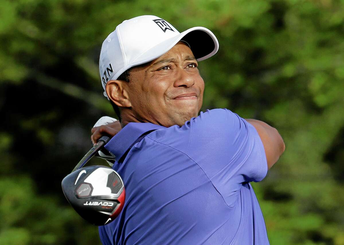 Tiger Woods watches his tee shot on the 10th hole during the first round of the PGA Championship golf tournament at Valhalla Golf Club on Thursday, Aug. 7, 2014, in Louisville, Ky. (AP Photo/John Locher)