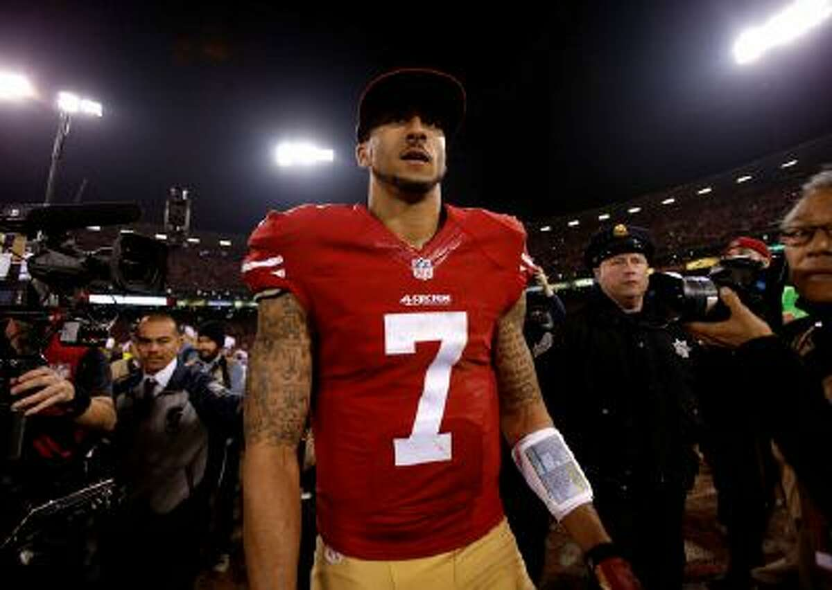 San Francisco 49ers' starting quarterback Colin Kaepernick (7) looks to shakes hands with other players following their 34-24 win against the Atlanta Falcons at Candlestick Park in San Francisco, Calif. on Monday, Dec. 23, 2013. (Nhat V. Meyer/Bay Area News Group)
