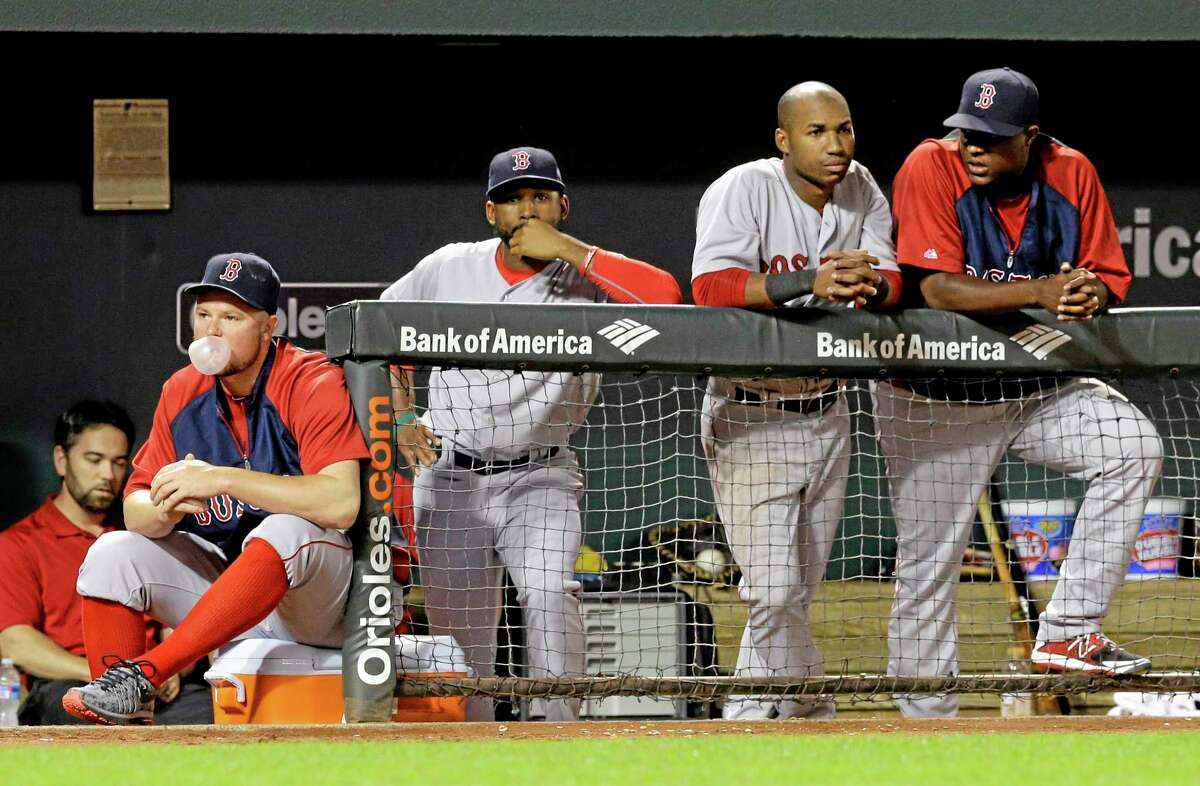 Members of the Boston Red Sox watch from the dugout in the ninth inning against the Orioles on Monday.
