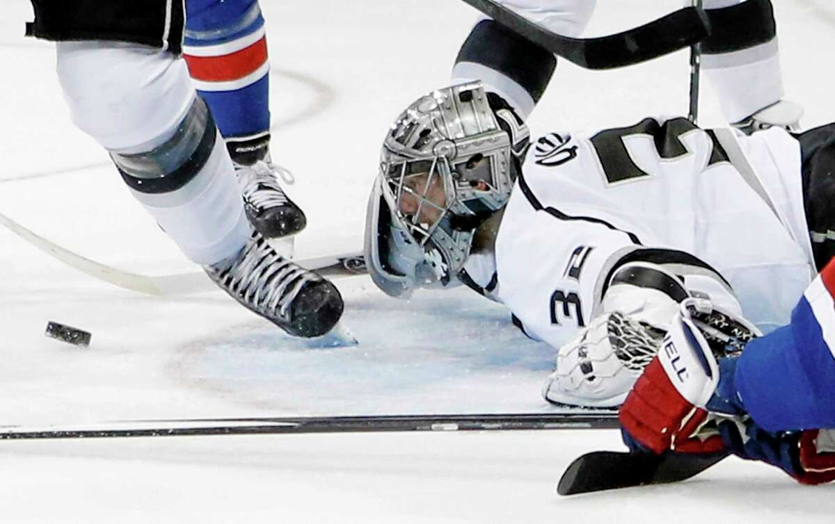 Los Angeles Kings goalie Jonathan Quick follows the rebound after blocking a shot against the New York Rangers in the second period Monday.