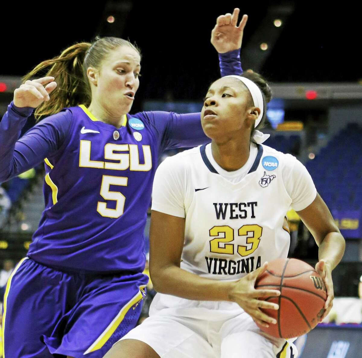 West Virginia guard Bria Holmes (23), a Hillhouse grad, has been named the Big 12 Preseason Player of the Year.