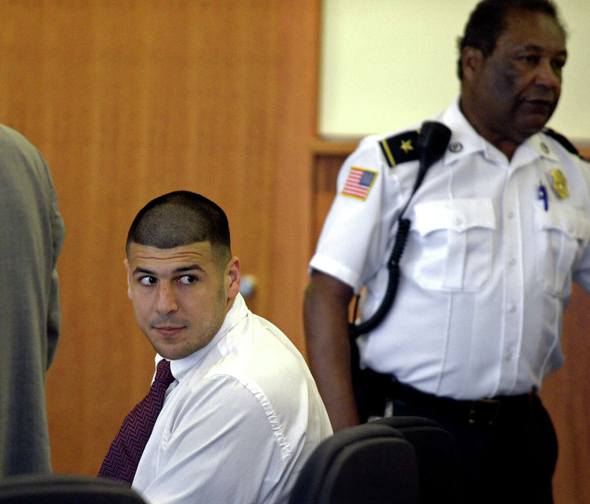Former New England Patriots tight end Aaron Hernandez looks back during a hearing on Tuesday in Fall River Superior Court in Fall River, Mass.