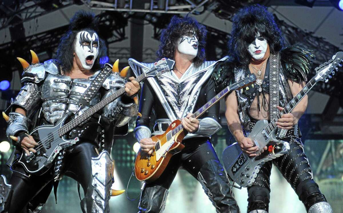 FILE - In this Thursday June 13, 2013, file photo, from left: bassist Gene Simmins , guitarist Tommy Thayer and singer Paul Stanley of the US band Kiss perform on stage in Berlin, Germany.