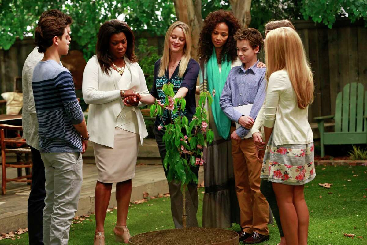 """This photo released by ABC Family shows, from left, Jake T. Austin, Lorraine Toussaint, Teri Polo, Sherri Saum, Hayden Byerly, and Maia Mitchell, in a scene from """"The Fosters,"""" on ABC Family. The media advocacy group GLAAD on Wednesday, Oct. 1, 2014, released its annual report on diversity on TV, including depictions of gay characters. (AP Photo/ABCFamily, Ron Tom)"""