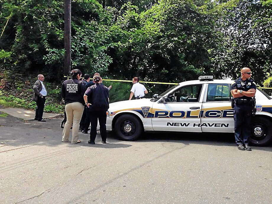 A man was shot while in a vehicle near the intersection of Warren Place and Ridge Street in New Haven early Thursday afternoon. The victim was taken to hospital by ambulance. Photo: Rich Scinto — New Haven Register