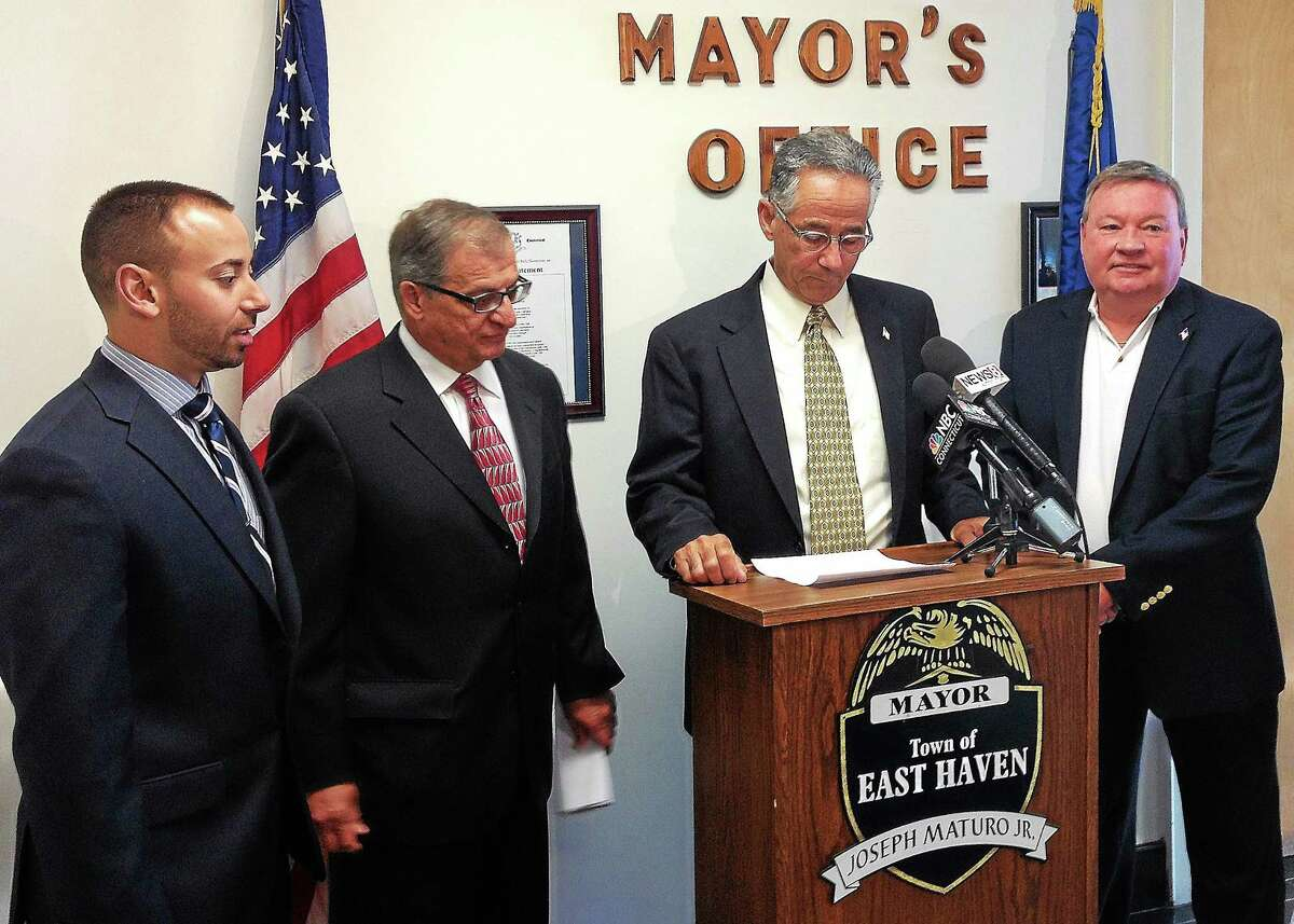East Haven Mayor Joseph Maturo Jr. took to the podium Monday to announce that the town has reached a $450,000 settlement with the nine plaintiffs who sued the Police Department in October 2010, alleging various civil rights violations. To his left is Board of Police Commissioners Chairman William Illingworth. Second from Maturo's right is Town Attorney Joseph Zullo. At the mayor's immediate right is special counsel Lawrence C. Sgrignari. (Evan Lips - New Haven Register)