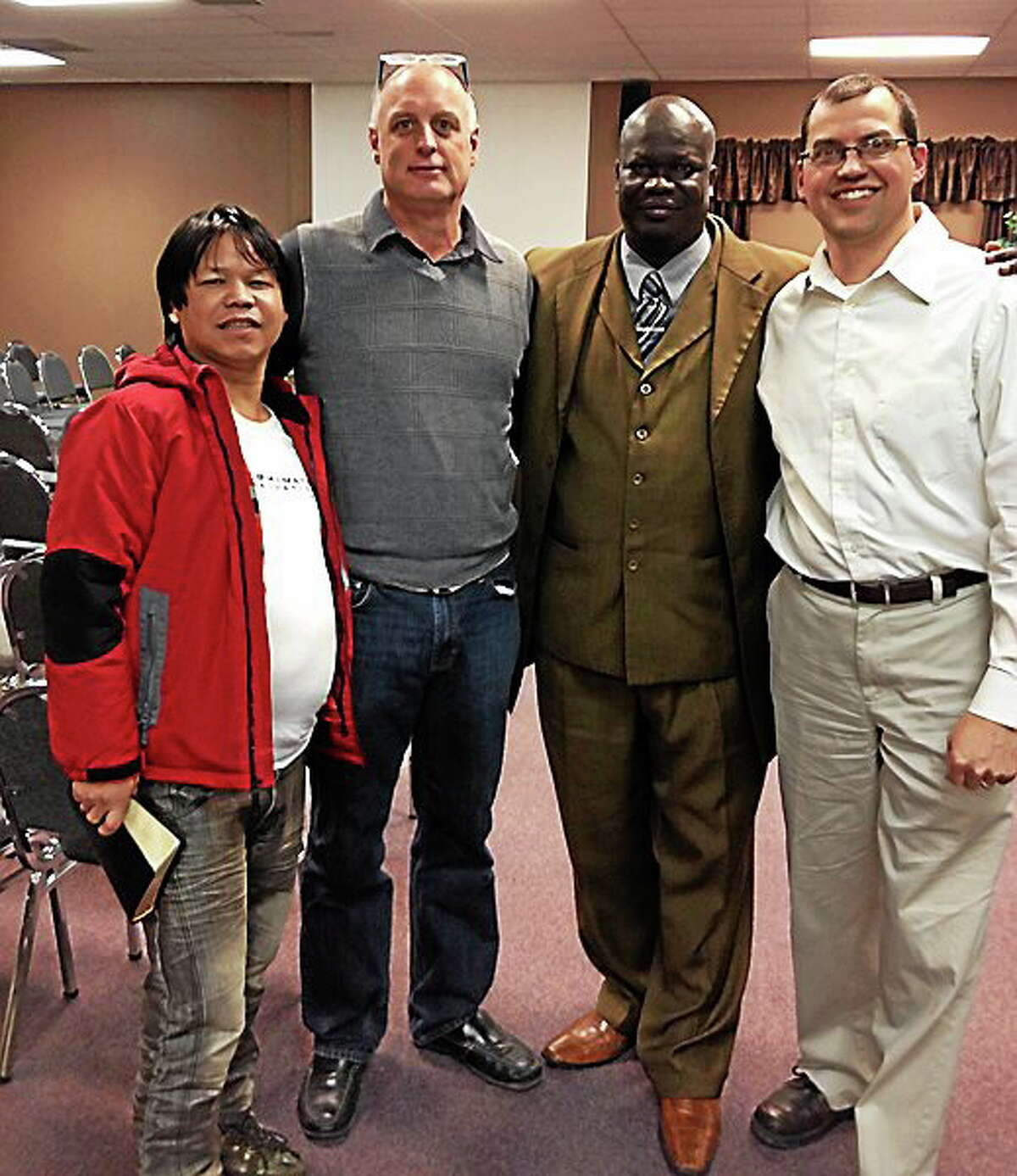 Left to right, Deepak Gerung, lead pastor of Emmanuel International Church; Kevin Zaun, lead pastor of Heartland Community Church; Paul Agamiri, lead pastor of All Nations Assembly of God; and Shawn Stoll, assistant pastor of All Nations Assembly of God, stand together at Heartland Community Church.