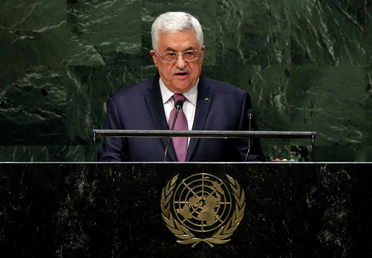 FILE - In this Friday, Sept. 26, 2014 file photo, President Mahmoud Abbas, of Palestine, addresses the 69th session of the United Nations General Assembly, at U.N. headquarters. The Palestinians are asking the U.N. Security Council to set a deadline of November 2016 for an Israeli withdrawal from all Palestinian territory occupied since 1967 including East Jerusalem in a new push to achieve independence. The circulation of the draft resolution to council members follows Abbas' announcement to the U.N. General Assembly last Friday that he would ask the council to set a deadline for a pullout and dictate the ground rules for any talks with Israel.(AP Photo/Richard Drew, File)