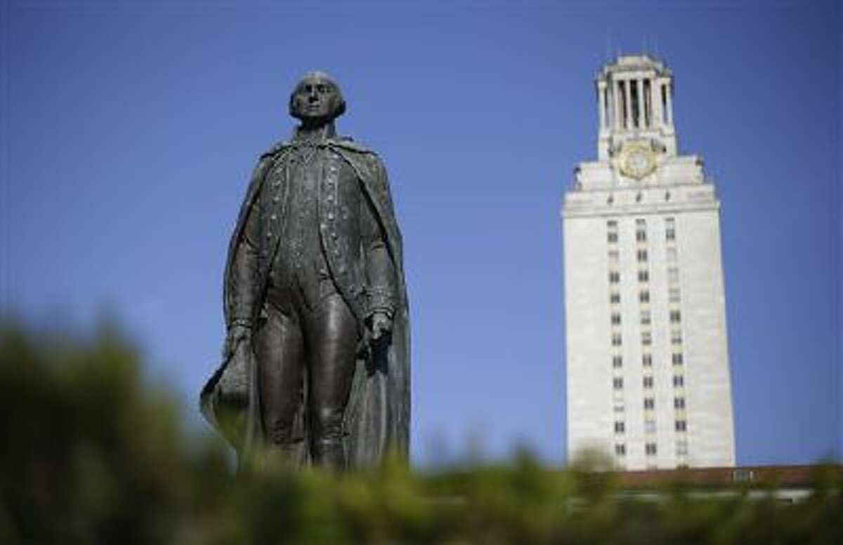ADVANCE FOR SUNDAY FEB. 3 AND THEREAFTER - A statue of George Washington stands near the University of Texas Tower at the center of campus, Thursday, Nov. 29, 2012, in Austin, Texas. If colleges were automobiles, the University of Texas at Austin would be a Cadillac: a famous brand, a powerful engine of research and teaching, a pleasingly sleek appearance. Even the price is comparable to the luxury car's basic model: In-state tuition runs about $40,000 for a four-year degree. (AP Photo/Eric Gay)