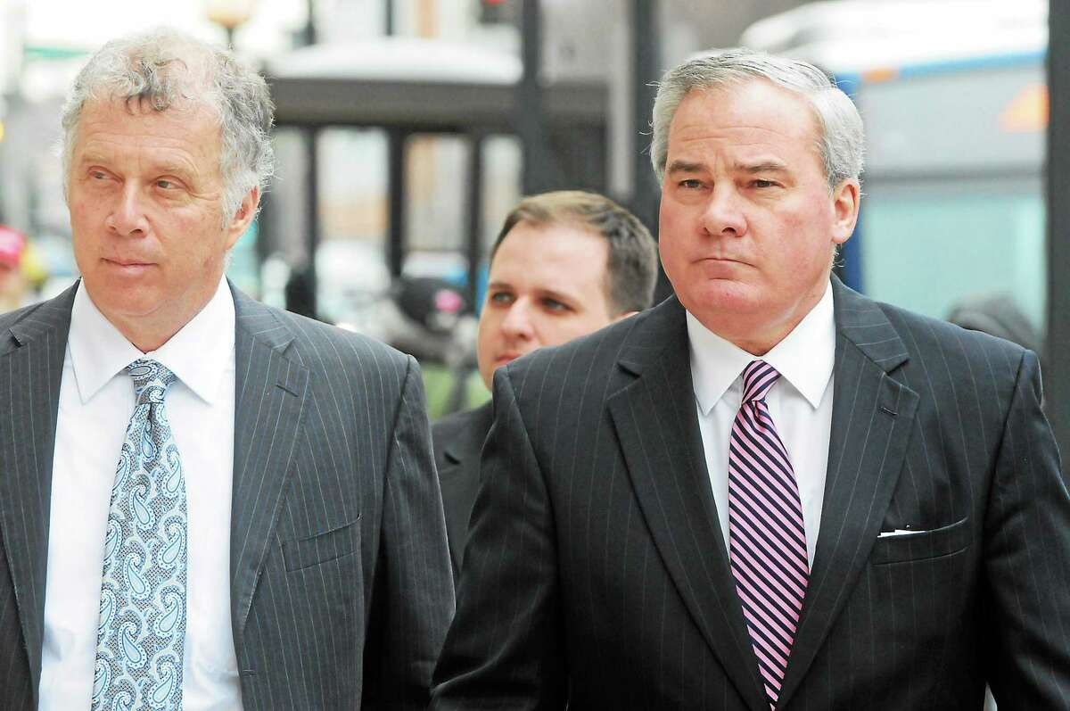 Ex-Gov. John Rowland arrives at federal court in New Haven to be arraigned Friday. Peter Hvizdak - New Haven Register