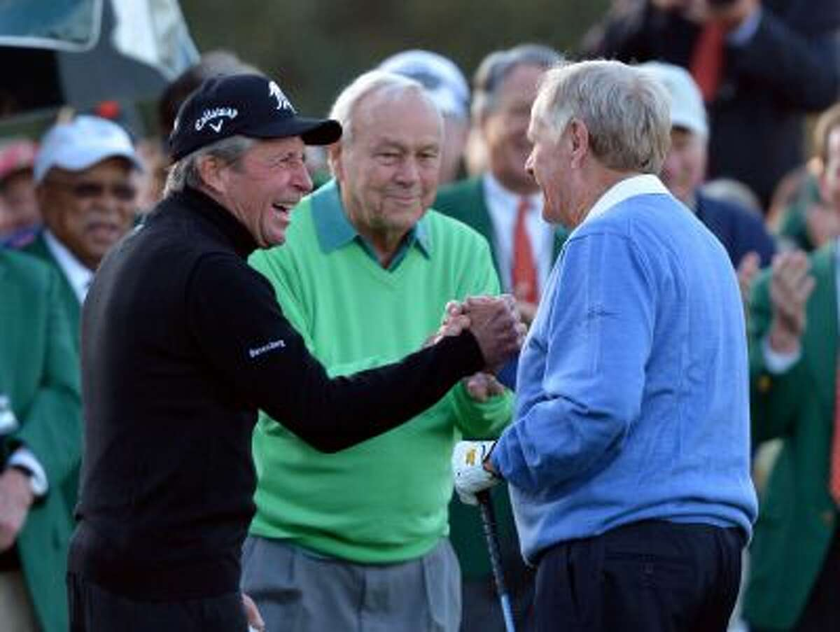 From left, Gary Player, Arnold Palmer and Jack Nicklaus shake hands after hitting ceremonial drives on the first tee during the first round of the Masters golf tournament Thursday, April 10, 2014, in Augusta, Ga. (AP Photo/Atlanta Journal-Constitution, Curtis compton) MARIETTA DAILY OUT; GWINNETT DAILY POST OUT; LOCAL TV OUT; WXIA-TV OUT; WGCL-TV OUT