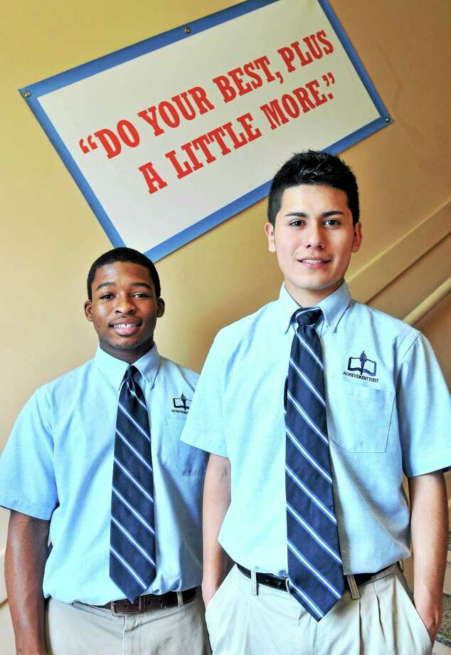 Achievement First Amistad High School seniors Spencer Munroe, left, and David Guzhnay will be attending Yale University in fall. Photo: Arnold Gold — New Haven Register