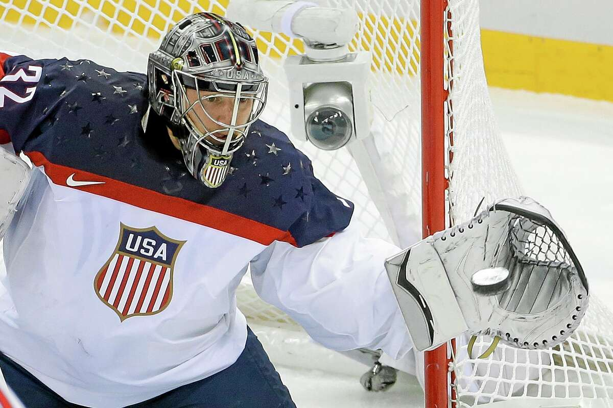 USA goaltender Jonathan Quick of Hamden catches a shot on goal during the first period of the United States' 5-2 win over the Czech Republic in Shayba Arena on Wednesday at the Winter Olympics in Sochi, Russia.