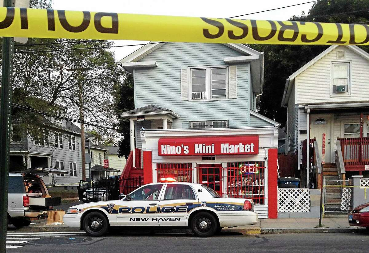 Police blocked off Nino's Mini Market, 659 Washington Ave. in New Haven as they investigated a deadly shooting that happened overnight. A clerk at that store reportedly said he a fatally shot a man who tried to rob him.