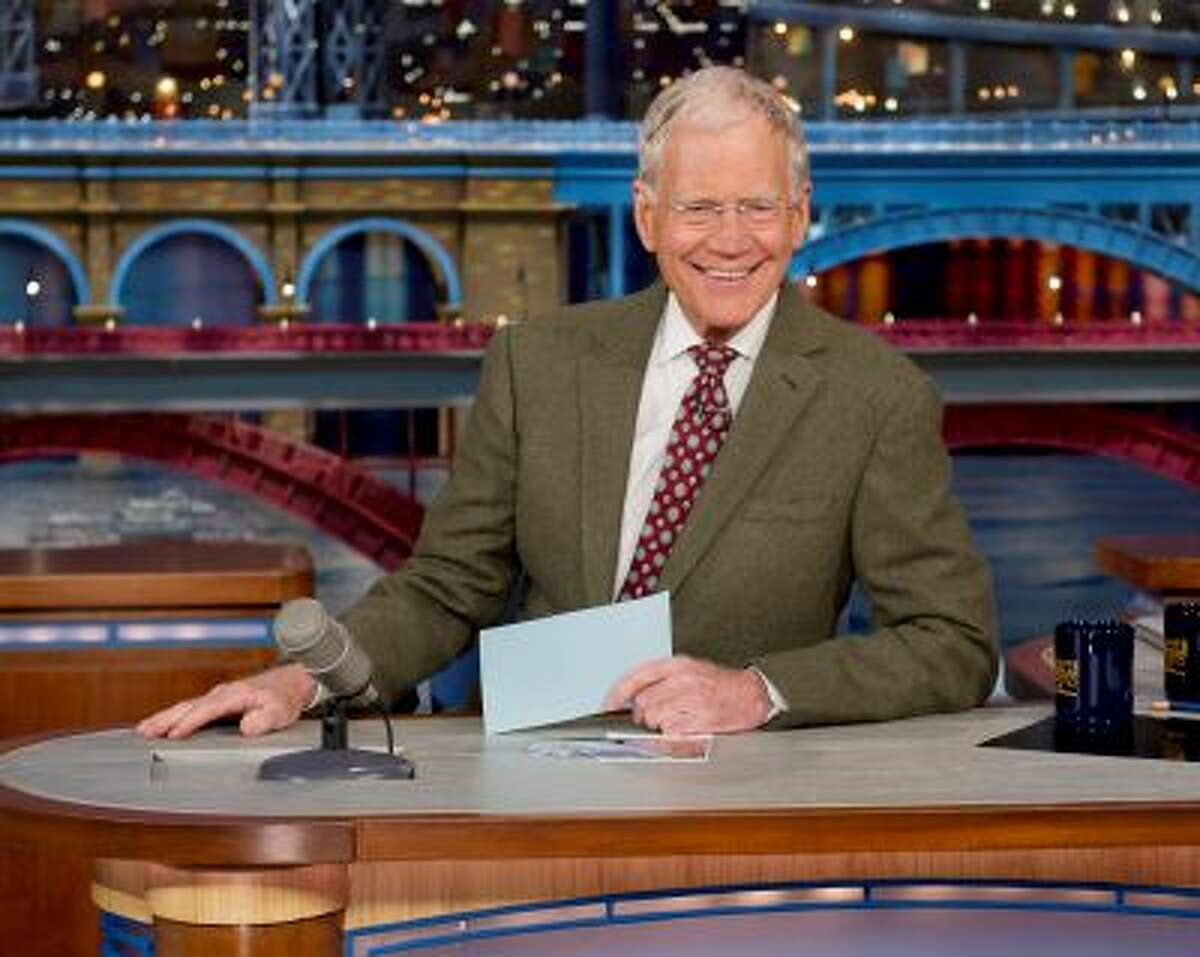 FILE - In this April 3, 2014 file photo provided by CBS, David Letterman, host of the Late Show with David Letterman, is seated at his desk in New York. Letterman has announced that he will retire in 2015 when his contract expires. (AP Photo/CBS, Jeffrey R. Staab) MANDATORY CREDIT, NO SALES, NO ARCHIVE, FOR NORTH AMERICAN USE ONLY