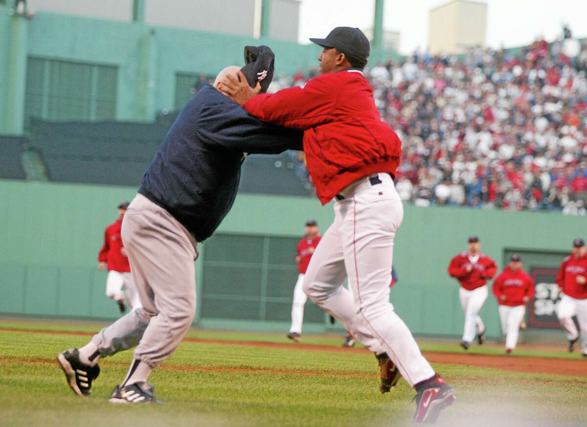 In this Oct. 11, 2003 file photo, Boston Red Sox pitcher Pedro Martinez, right, grabs New York Yankees coach Don Zimmer by the head before throwing him to the ground during a fourth-inning altercation in Game 3 of the American League championship series in Boston.
