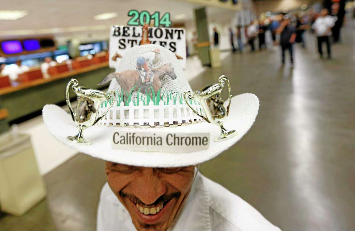 Edwin Collazo of Brooklyn wears a hat paying tribute to favorite California Chrome before the Belmont Stakes Saturday at Belmont Park in New York.