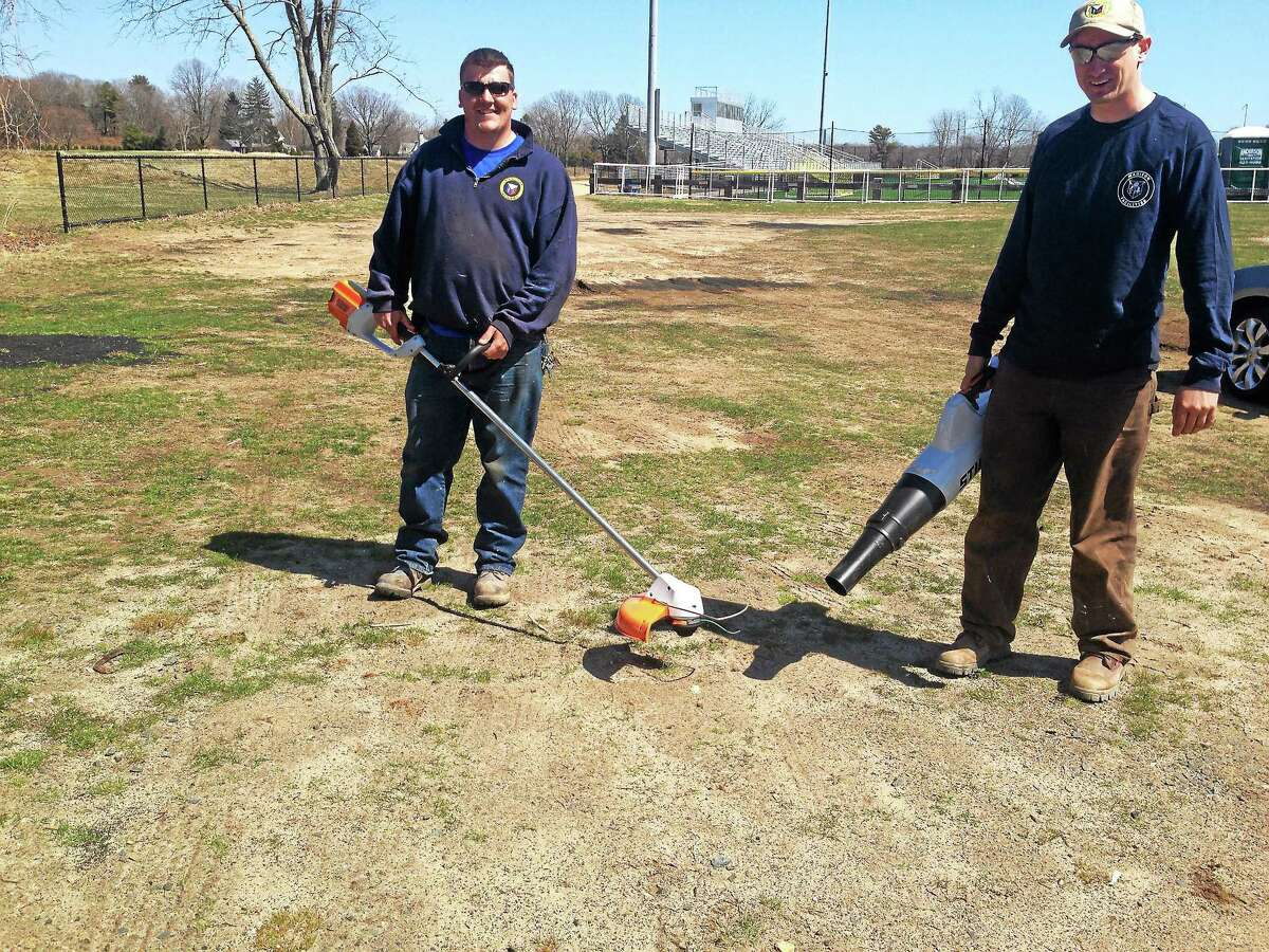 Facilities employees Michael Vece, left, and Jared Twomey with battery-powered tools. Register photo — Sean Carlin