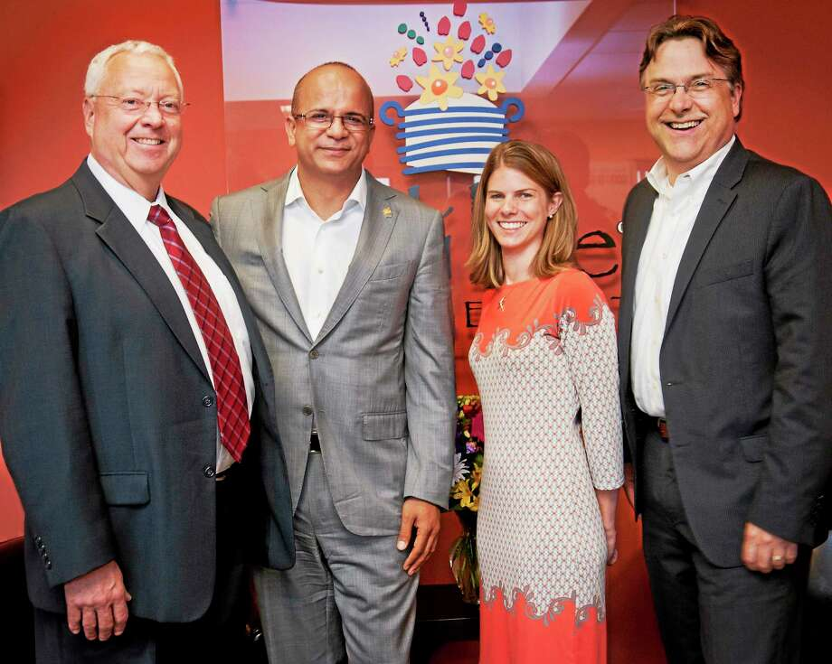 From left, New Haven Register CFO John Collins; Edible Arrangements International Inc. CEO Tariq Farid; Mary-Kate Bzdyra of the New Haven Register; and Tom Wiley, executive vice president, sales, at Digital First Media. Photo: Melanie Stengel — New Haven Register