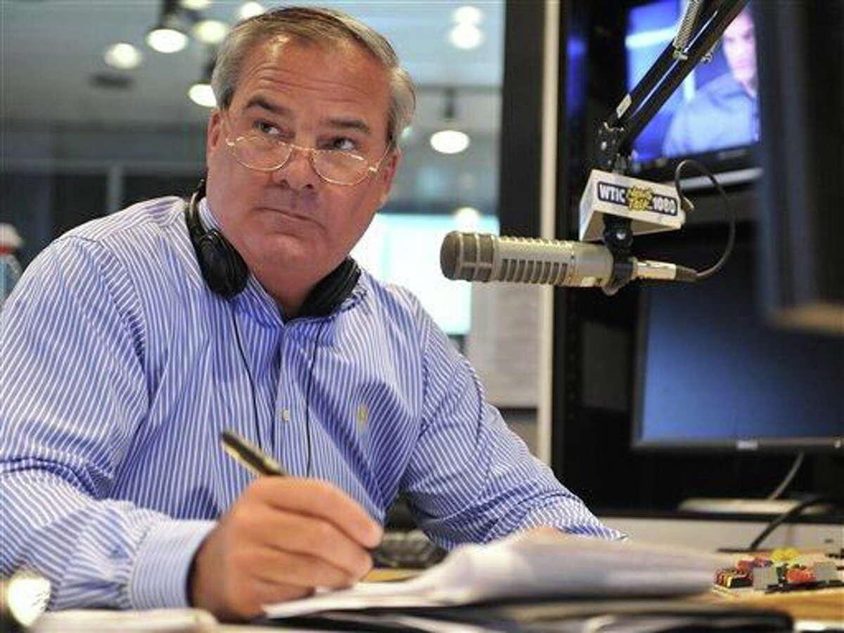 Former Connecticut Gov. John Rowland fills in as a talk show host on WTIC AM radio in Farmington, Conn., Friday, July 2, 2010. (AP Photo/Jessica Hill)