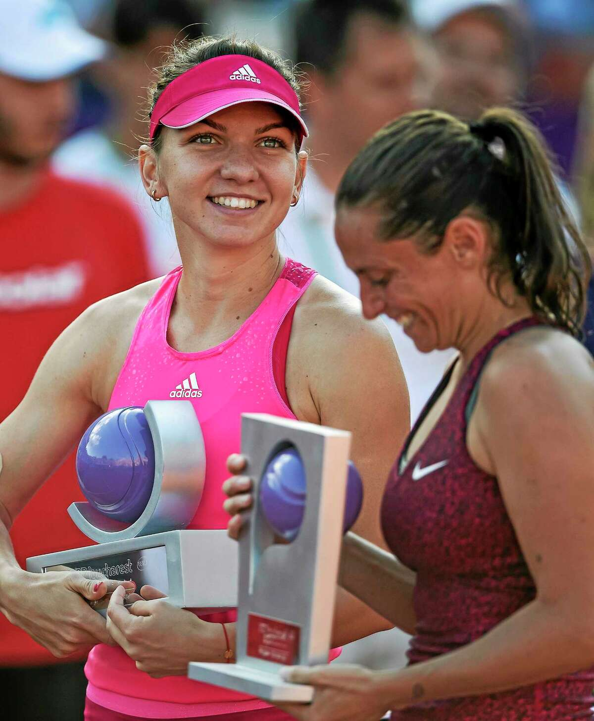 Simona Halep, left,will return to New Haven to defend her title in the re-named Connecticut Open.