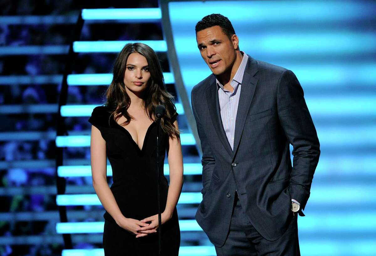 Model Emily Ratajkowski, left, and Tony Gonzalez speak on stage at the 3rd annual NFL Honors at Radio City Music Hall in New York on Feb. 1.