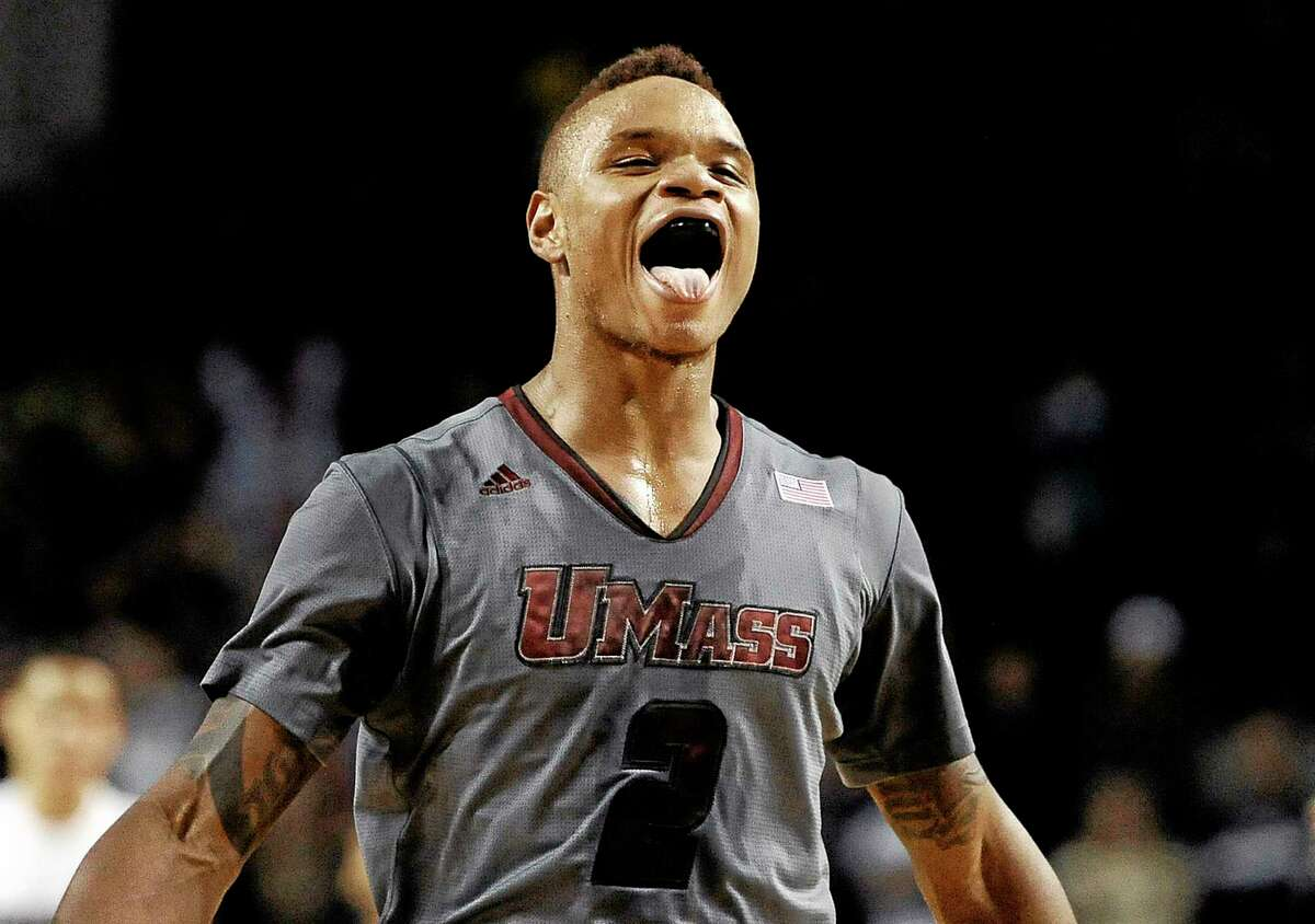 In this Dec. 28, 2013 file photo,†UMass guard Derrick Gordon celebrates after hitting the go-ahead basket with one second left on the clock during overtime of an NCAA college basketball game against Providence, in Amherst, Mass. Gordon says in a televised interview that he is gay. Gordon made the announcement on ESPN on Wednesday, April 9, 2014, becoming the first openly gay player in Division I men's basketball. (AP Photo/Jessica Hill, File)