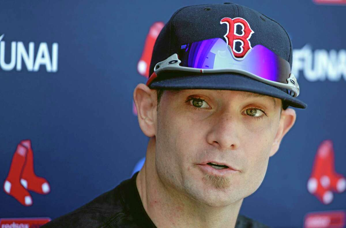 Beardless Boston Red Sox left fielder Jonny Gomes speaks with reporters during practice on Tuesday in Fort Myers, Fla.