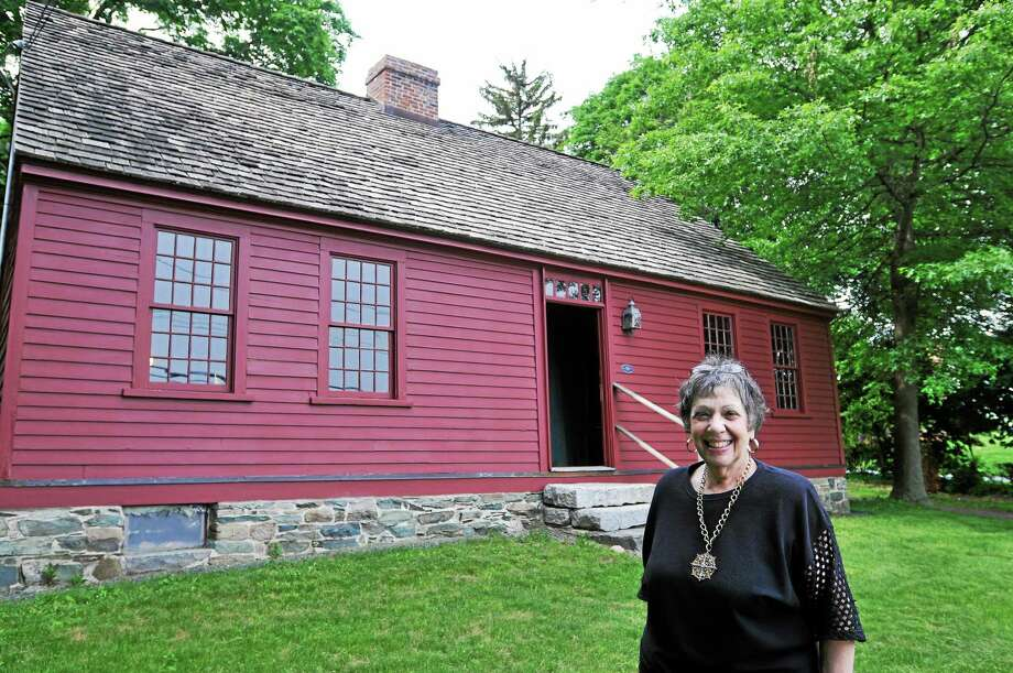 Ginny Reinhard, president of the Orange Historical Society, has overseen the restoration of the Nathan Bryan-William Andrew House in Orange. Photo: Peter Casolino — New Haven Register