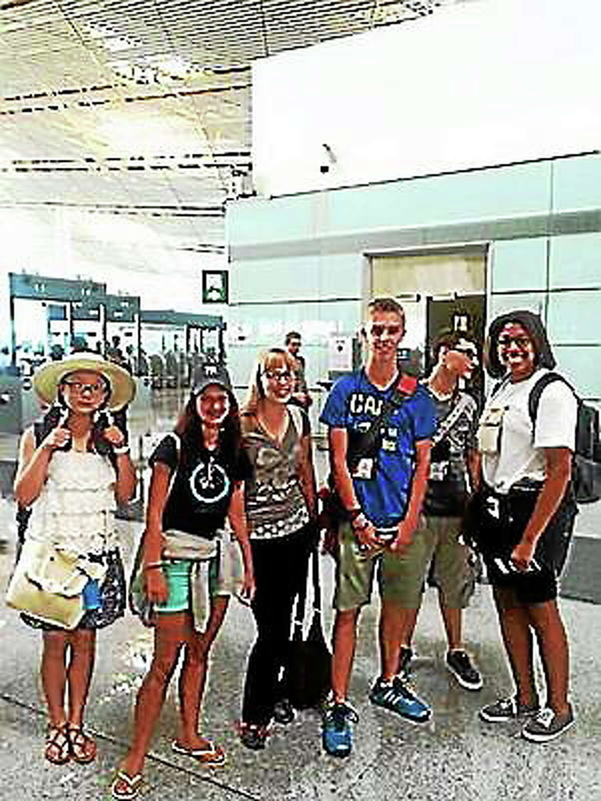 The students pose for photo as they arrive in China.
