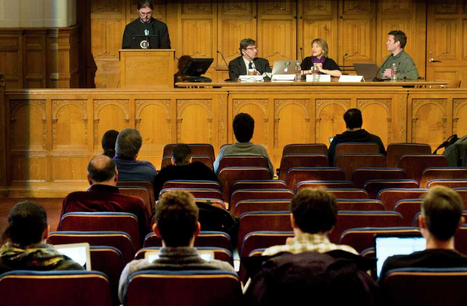 Yale students listen to a panel of experts at Yale Law School speak on computer hacking Tuesday in New Haven. From left are Christopher Soghoian, Matt Blaze, Jennifer Valentino and Axel Arnbak. Photo: Melanie Stengel — New Haven Register
