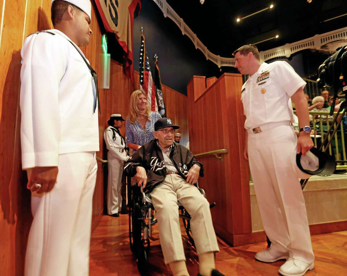 Baseball Hall of Famer Yogi Berra is honored by the U.S. Navy for his service 70 years ago during the D-Day Invasion at a ceremony at the Yogi Berra Museum Friday in Montclair, New Jersey.