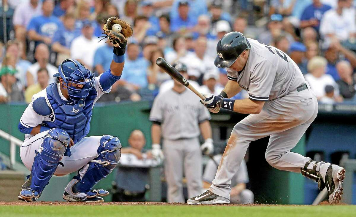 New York Yankees' Mark Teixeira, right, ducks after being hit by a pitch thrown by Kansas City Royals starting pitcher Jeremy Guthrie during the third inning of a baseball game Friday, June 6, 2014, in Kansas City, Mo. (AP Photo/Charlie Riedel)