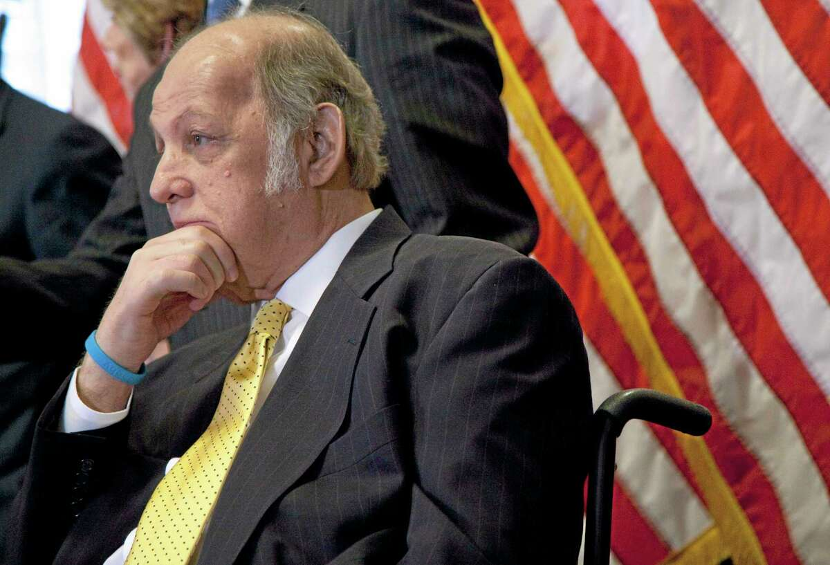 This March 30, 2011, file photo shows former White House press secretary James Brady, who was left paralyzed in the Reagan assassination attempt, during a news conference on Capitol Hill in Washington marking the 30th anniversary of the shooting.
