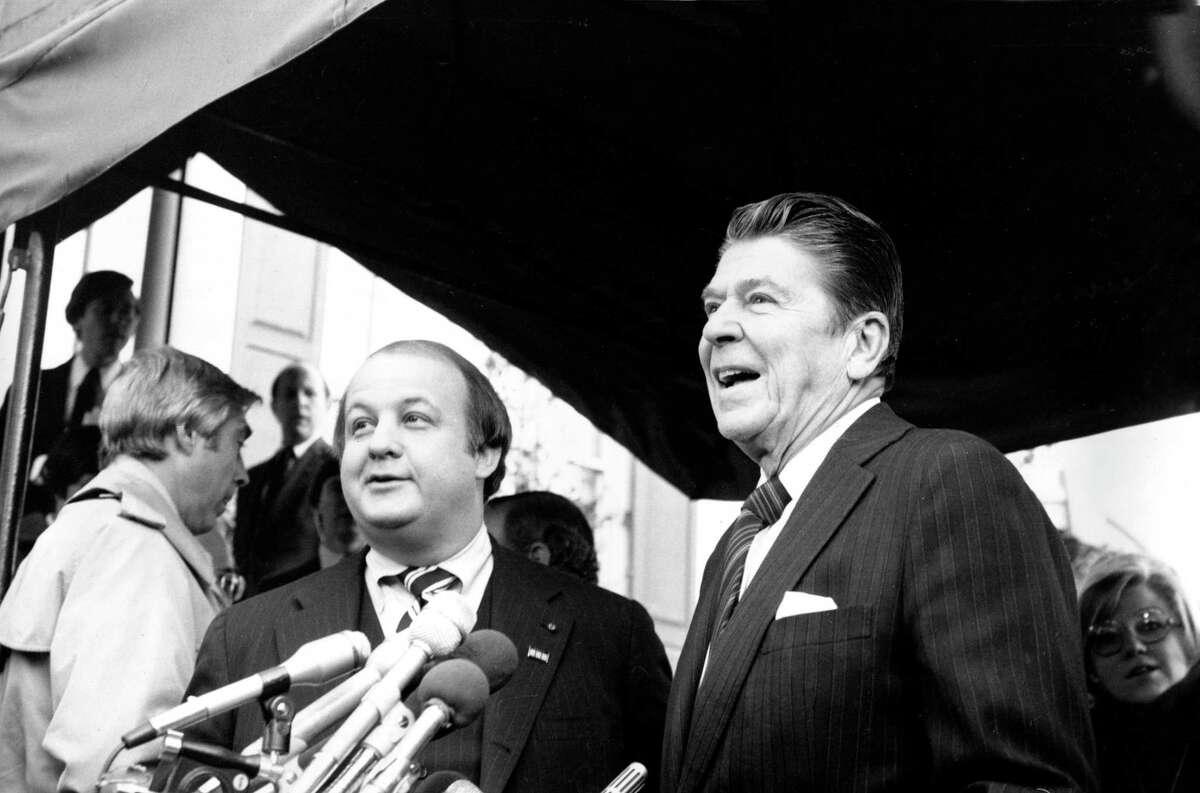 This Jan. 6, 1981, file photo shows President-elect Ronald Reagan introducing James Brady as his press secretary in Washington.
