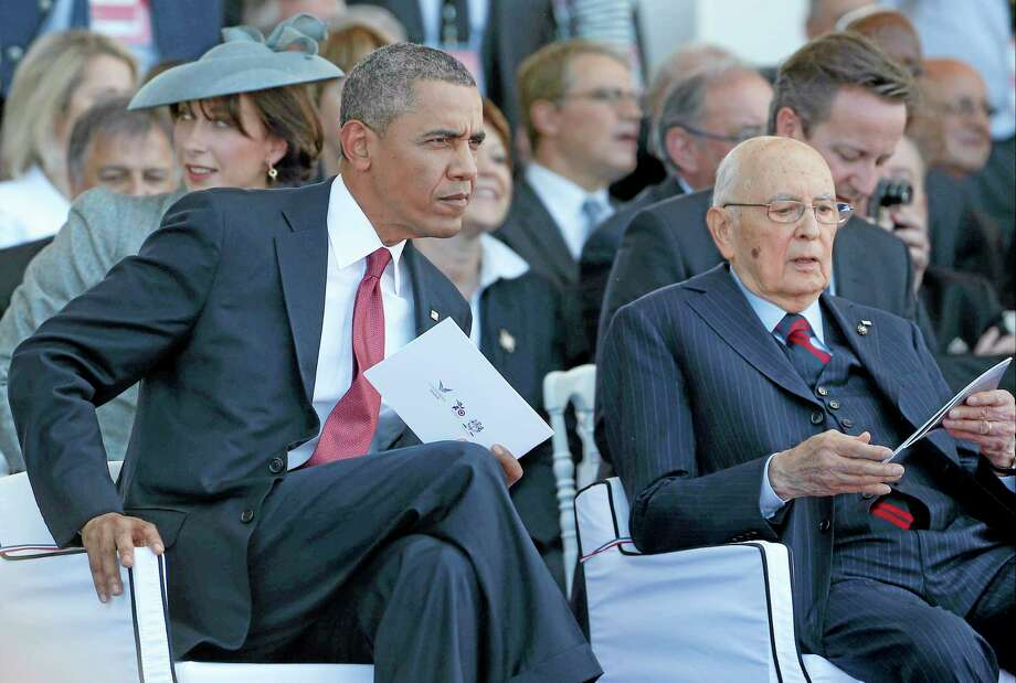 President Barack Obama sits with Italian President Giorgio Napolitano as they take part in the 70th anniversary of D-Day at Sword Beach in Ouistreham, France, Friday, June 6, 2014. Photo: Associated Press   / AP