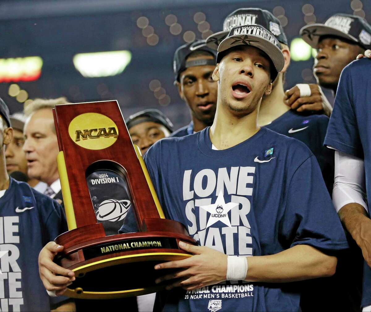 UConn's Shabazz Napier holds the championship trophy after defeating Kentucky 60-54 on Monday.