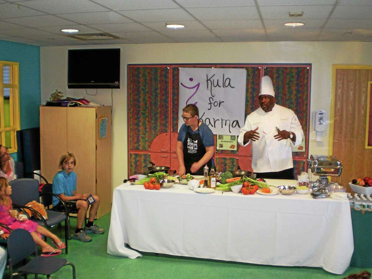 """""""Chopped"""" winners Hunter Zampa, left, and Darius Peacock teamed up on Zampa's tortellini dish at Yale-New Haven Children's Hospital."""