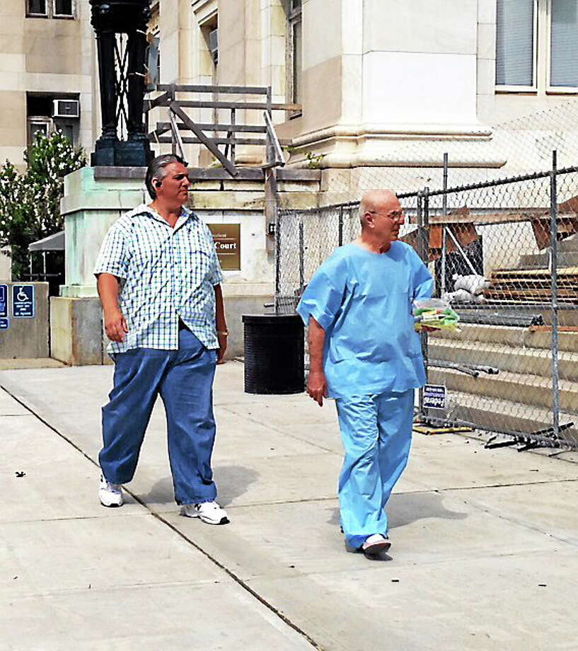 """Anthony Anamasi, right, walks with bail bondsman """"Big"""" Steve Tracey after posting bail Monday. Photo: Rich Scinto — New Haven Register"""