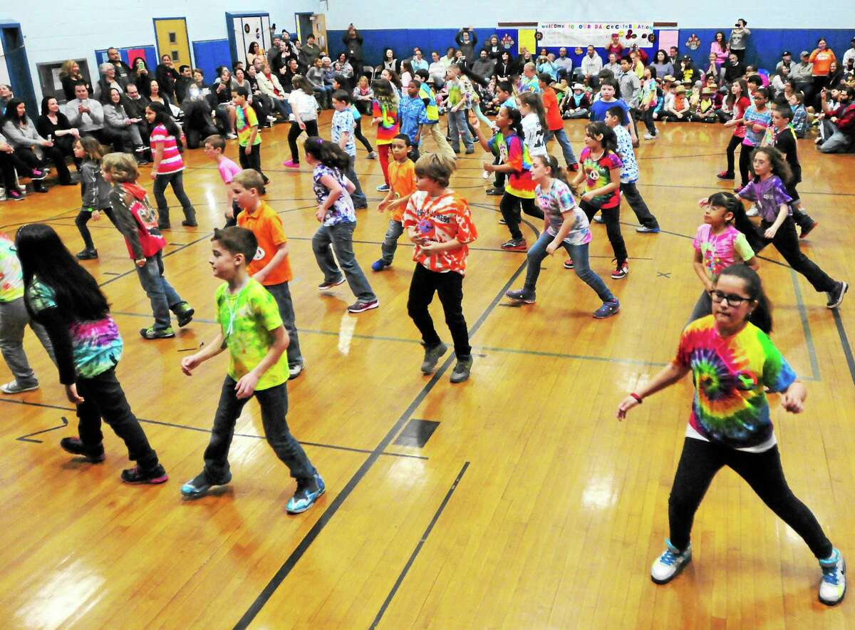 Momauguin Elementary School fourth-graders dance to popular music while doing math during a program at the East Haven school Tuesday.