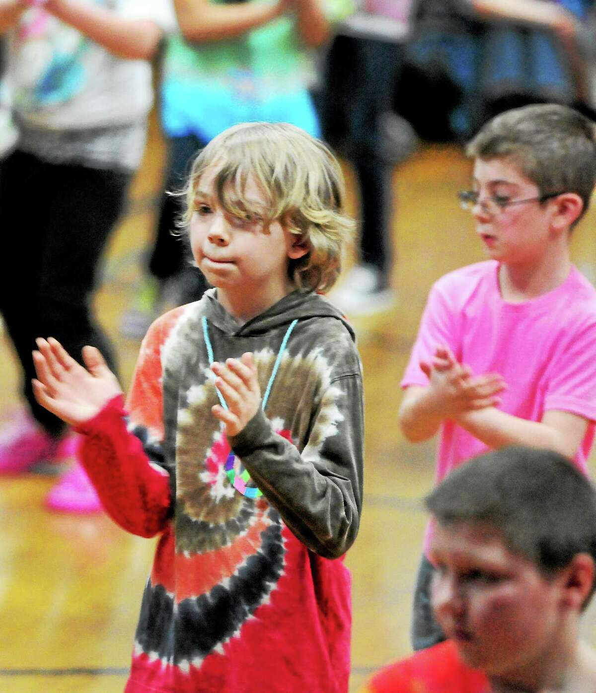 Momauguin Elementary School fourth-grader Kodi Curtis dances with his class while doing math during a program at the East Haven school Tuesday.